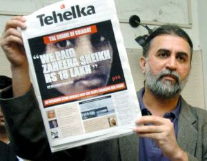 Former Editor-in-Chief of Tehelka, Tarun Tajpal with his magazine, Tehelka. Source: knowyourlaw.com